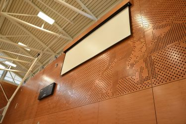 Motorized screen in the Gym